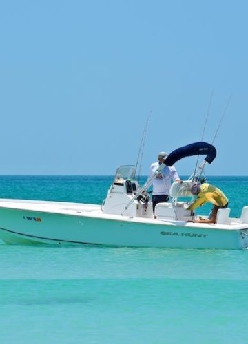 A group of men fishing on a boat in Florida